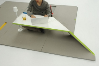 Land Peel – Foldable floor mat that transforms into furniture
